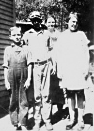 1924 Copperhill Left to right- Charles E. Higdon, brother Reese Higdon, mother Mary Arp Higdon, and cousin Kathryn Franklin (daughter of Lena Arp Franklin)
