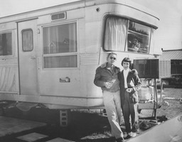 1957 - Mary Carmel & Tom in front of their mobile home, Augusta, GA