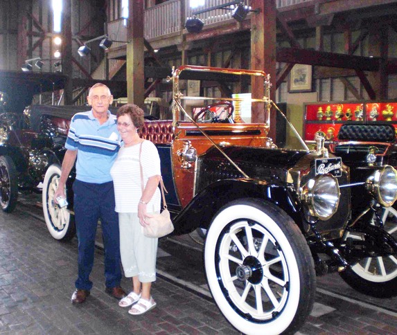 Eugene and Georgina Smith at one of the car barns in the Gilmore Car Museum