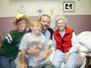 Stella Higdon, wife of Sam Higdon, with her grandson Ryan and great grandsons Joshua and Jacob